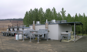 An outdoor energy substation project near a group of trees