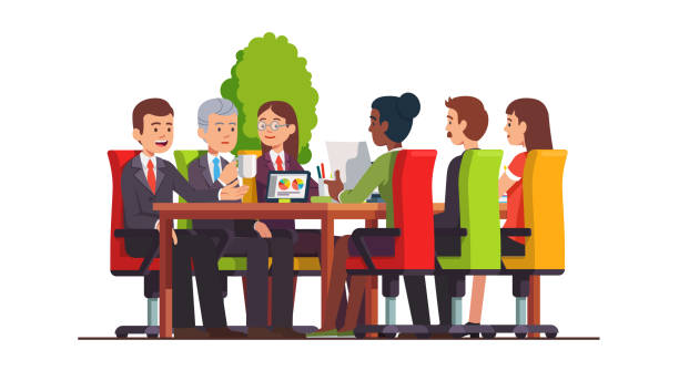 people sitting at desk working together